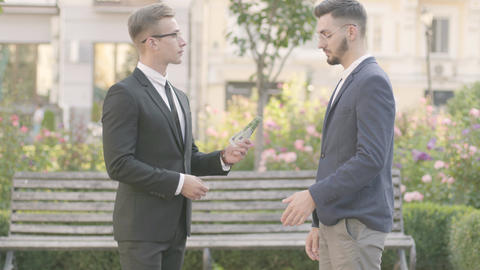 Two attractive and confident young businessmen in an official suits made Live Action