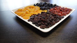 plate of dried fruit. raisins, dried apricots, prunes, dried cherries. the Live Action