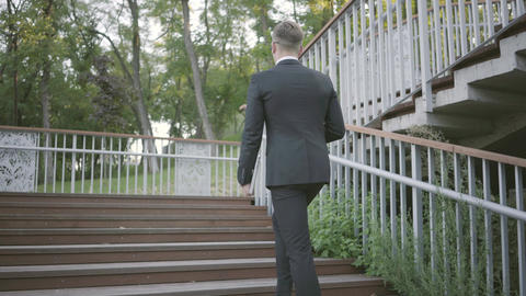 Successful stylish well-dressed businessman in expensive suit and shoes walking Footage