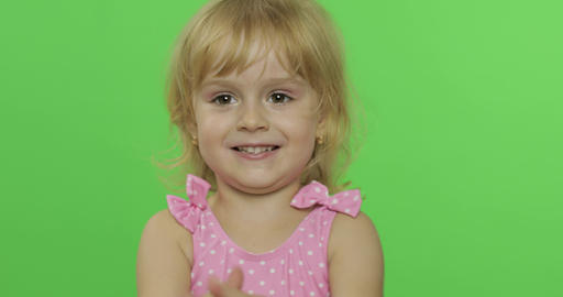 Positive girl emotionally make faces and smile in pink swimsuit. Chroma Key Footage
