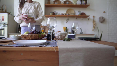 Beautiful wooden kitchen - a girl prepares for the arrival of guests, prepares Live Action