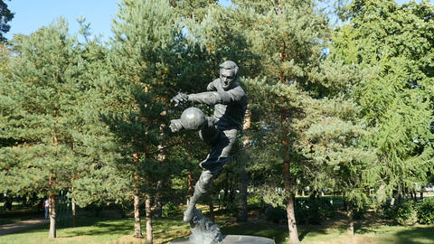 football player monument Live Action