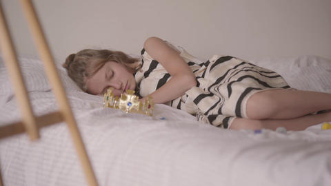Cute sleeping calm caucasian girl lying in his comfortable bed. The child Footage