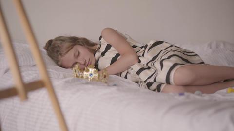 Cute sleeping calm caucasian girl lying in his... Stock Video Footage