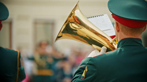 A wind instrument military parade - a man in army costume playing musical Live Action
