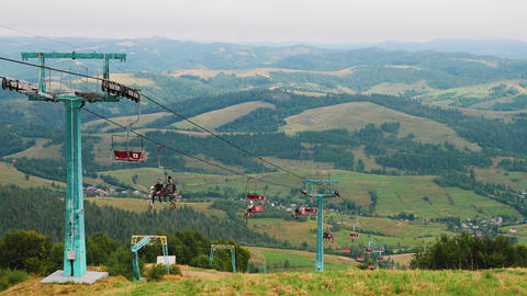 People with bicycles climb on the cable car in the summer…, Live Action