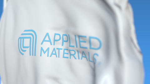 Flying flag with Applied Materials logo, close-up. Editorial loopable 3D Live Action