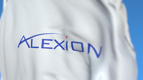 Waving flag with Alexion Pharmaceuticals logo, close-up. Editorial loopable 3D Live Action