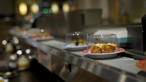 Sushi and Japanese Food on Conveyor Belt Footage