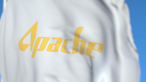 Flying flag with Apache Corporation logo, close-up. Editorial loopable 3D Live Action