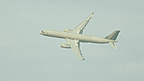 Passenger plane flying in the sky in overcast weather Live Action