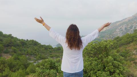 Traveling woman enjoying morning landscape in foggy mountain. Tourist woman Footage