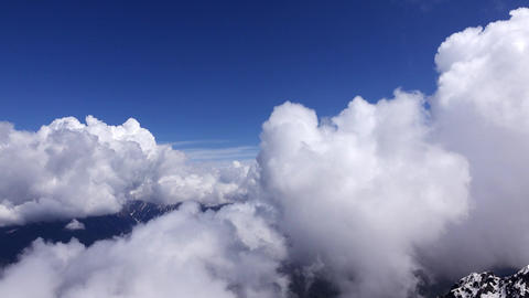 Cloud formations whirl at mountain top, high altitude, time lapse Footage