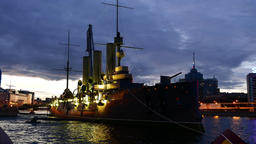 Brightly illuminated cruiser Aurora at night, SPb sight after restoration Footage