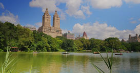 Daytime Establishing Shot of People in Rowboats on the Lake in Central Park Footage