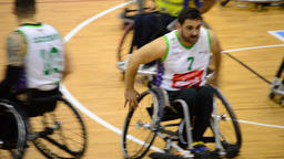 Players of wheelchair basketball playing a game Footage