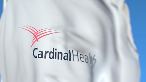 Flying flag with Cardinal Health logo, close-up. Editorial loopable 3D animation Live Action