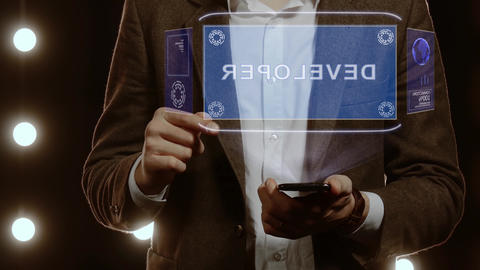 Businessman shows hologram with text Developer Footage