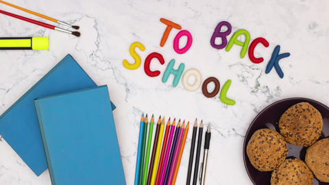 Back to school stop motion animation - School supplies on the table and title back to school moving Animation