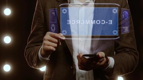 Businessman shows hologram with text E-commerce Live Action