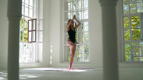 Healthy pretty flexible caucasian woman practicing yoga enjoying fitness Live Action