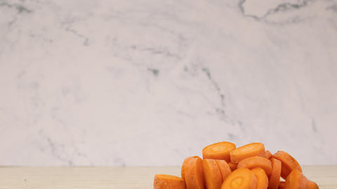 Stop motion animation of cutting fresh and organic carrot Animation