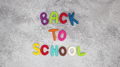 Back to school stop motion animation - Back to school tittle moving on gray background Animation