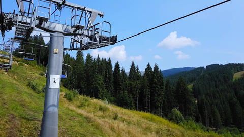 Cableway in the Carpathian mountains at the end of summer. 4K shooting cableway Footage