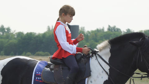 Girl with a red flag on a horse in a traditional Cossack costume Footage