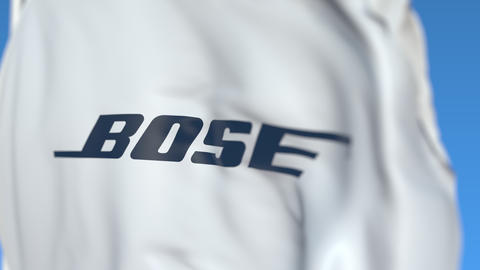 Flying flag with Bose Corporation logo, close-up. Editorial loopable 3D Live Action