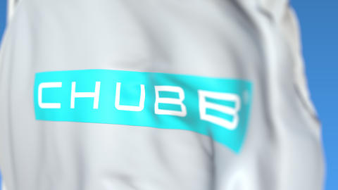 Flying flag with Chubb Limited logo, close-up. Editorial loopable 3D animation Live Action