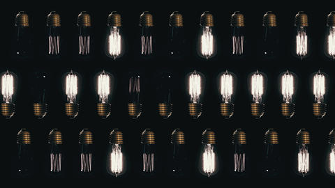Many bulbs blinking on a black background, 4k video Live Action