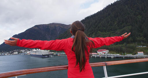 Cruise ship passenger in Alaska city of Ketchikan standing on cruise ship deck Live Action