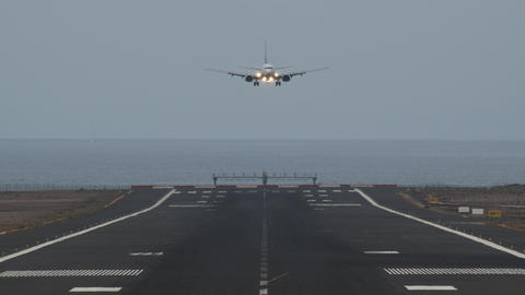 A boarding aircraft going towards the camera Footage