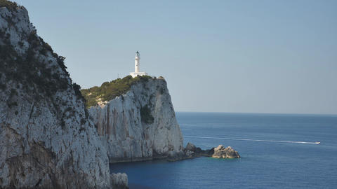 Dramatic coast line with a beautiful lighthouse on the cliff near the sea Live Action