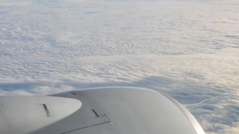 Aircraft engine closeup above the clouds Live Action