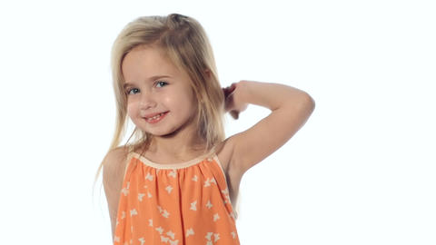 Little girl combing her long beautiful hair Stock Video Footage