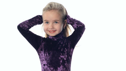 young girl the blonde irons the hair Stock Video Footage