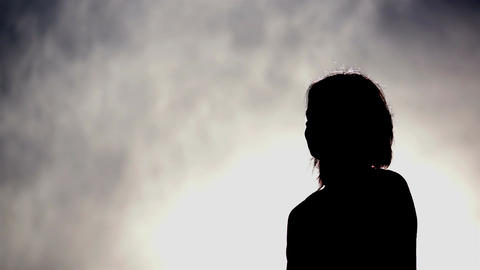 Silhouette of a Woman Drinking Water Stock Video Footage