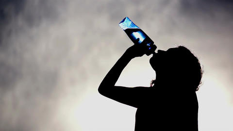 Silhouette Of A Woman Drinking Water stock footage