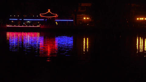 reflection on lake with splendid China ancient architectural lighting Footage
