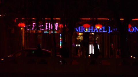 Neon bars Commercial Street at Beijing HouHai.walking... Stock Video Footage