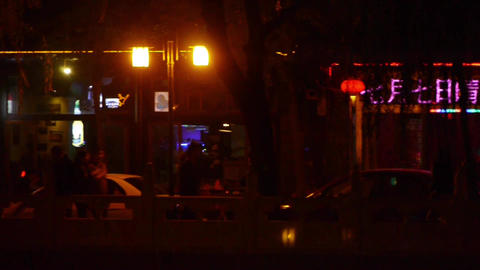 Neon bars Commercial Street at Beijing HouHai.walking pedestrian Footage