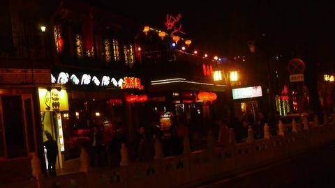 Neon bars Commercial Street at Beijing HouHai.walking... Stock Video Footage