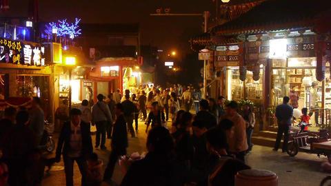 Crowd pedestrian people Walk on China Beijing night... Stock Video Footage