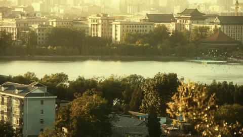 panoramic view of BeiJing BeiHai Park & flock of white pigeons on lake.dusk  Footage