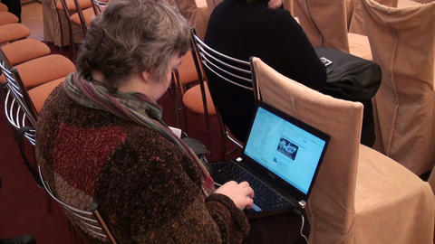 An elderly woman with a laptop Stock Video Footage