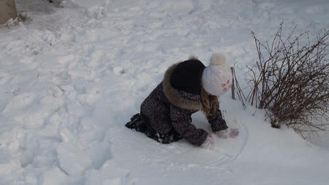 Girl playing with snow Stock Video Footage