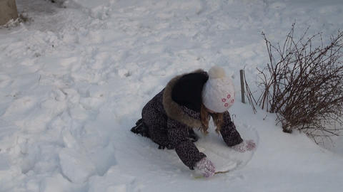 Girl playing with snow Footage