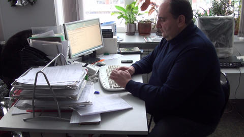 The Man In The Office At The Computer stock footage
